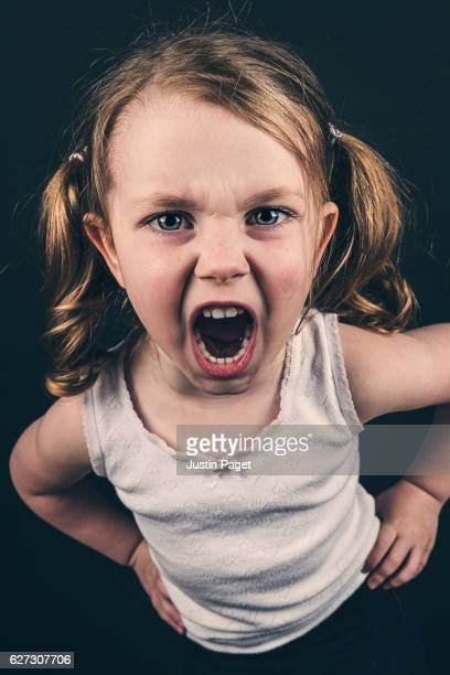 Young Angry Girl on black background