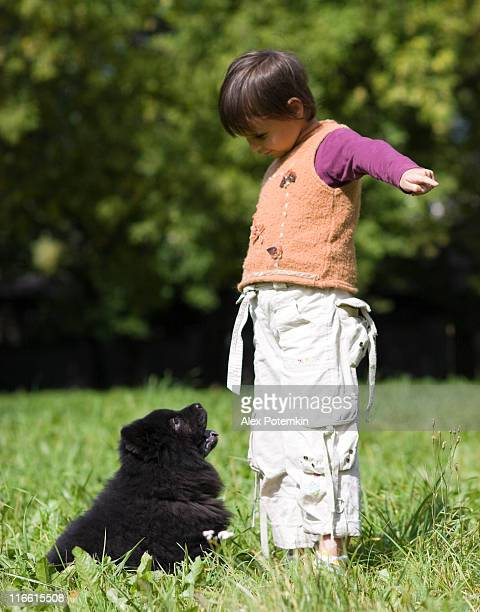 Young animal trainer: little girl with puppy