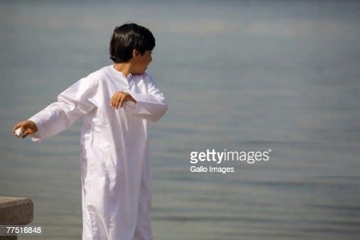 Young Arab Boy Playing Beside the Sea. Dubai, United Arab Emirates