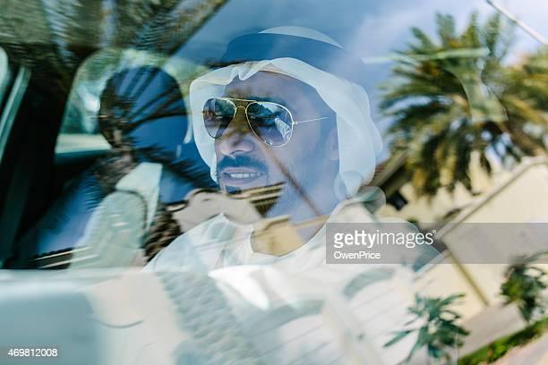 Young Arab businessman driving a car