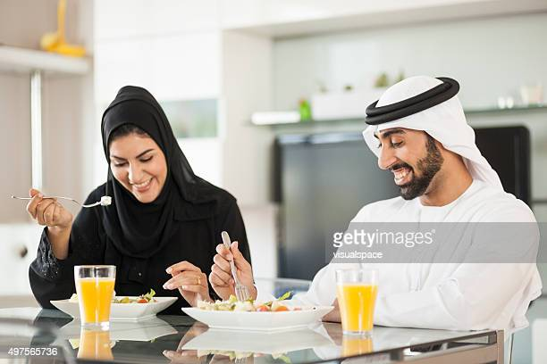 Young Arab Couple Eating at Home