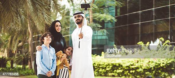 Young Arab family in a park taking selfie