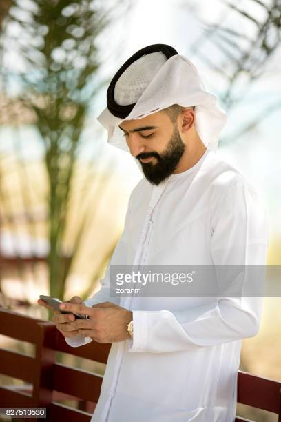 Young arab using smart phone