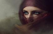 Young arabian woman in hijab with sexy blue eyes. Yashmak.