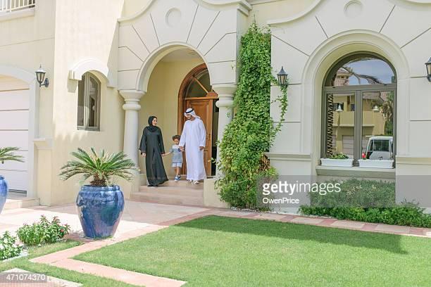 Young Arabic family leaving their luxury Dubai Villa