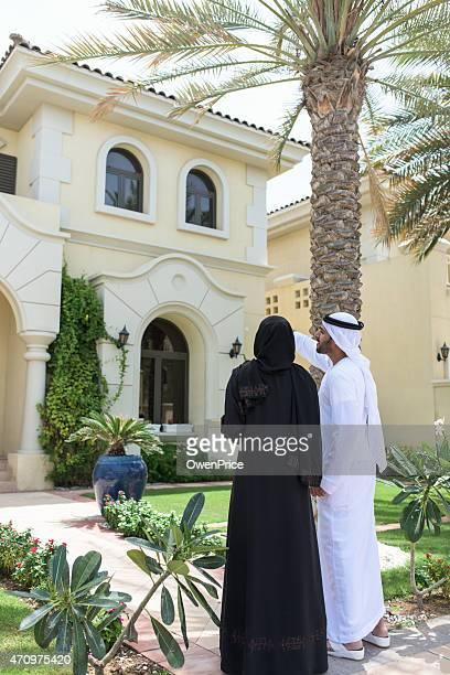 Young Arabic family viewing luxury Dubai Villa
