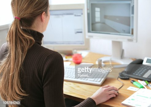 young architect in front of her monitor
