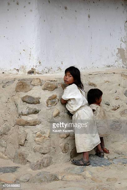 Young Arhuaco children hang around inside the walled village on January 23 2015 in Nabusimake Colombia Nabusimake is the spiritual center of the...