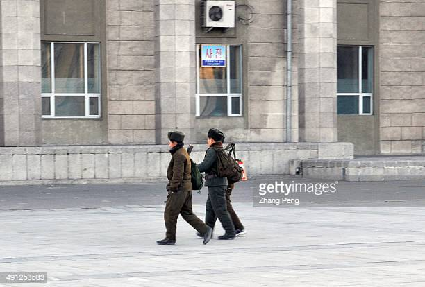Young army men walk on the street in Pyongyang
