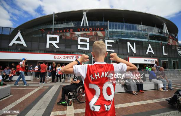 A young Arsenal wearing a shirt with new signing Granit Xhaka's name on his back before the game against Liverpool