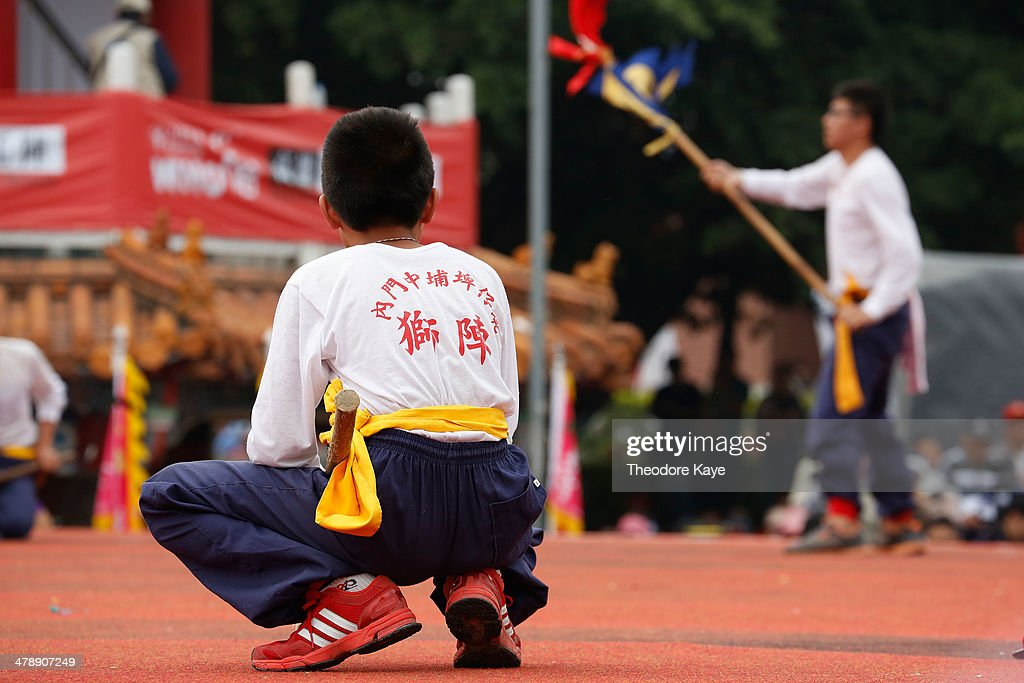 A young articipant in a Songjiang battle troupe watches a performance on March 15, 2014 in Neimen, Kaoshiung, Taiwan. Songjiang Battle Array or Song Jiang Zhen is a folk martial art particular to Taiwan. The martial art dates to the Ming Dynasty and draws inspiration from the Chinese epic novel, 'Outlaws of the Marsh.' A lot of the weapons used in the martial art were originally modifications of agricultural implements and farming tools, as it evolved as a self-defense military tactic for Taiwanese farmers against invaders. Every year, an intercollegiate Songjiang Battle Array competition is held in Neimen, coinciding with the festival marking the birthday of Guanyin Buddha.