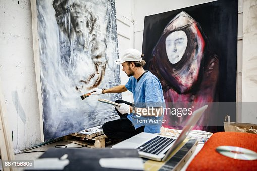 Young Artist working on big painting : Stock Photo