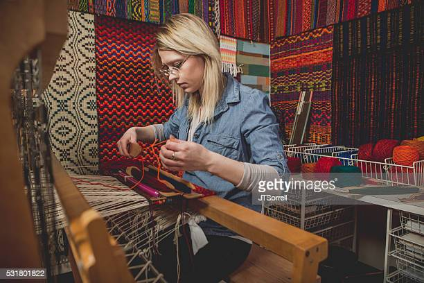 Young Artist Working with Fibers on a Loom