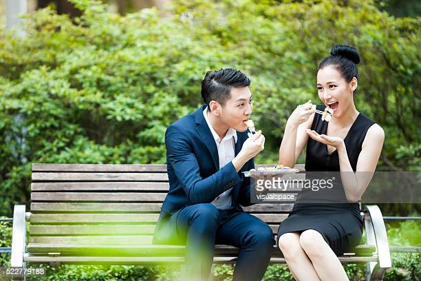 Young Asian Business Colleagues Having Fun Lunch in a Park