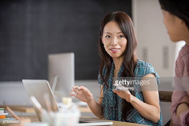 Young Asian businesswoman at work