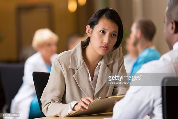 Young Asian businesswoman conducting interview to hire employee