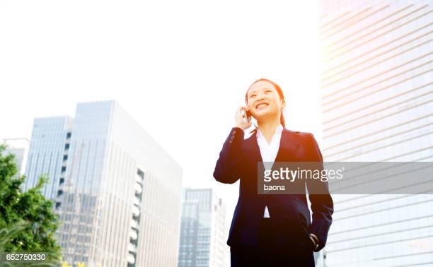 Young asian businesswoman on the phone