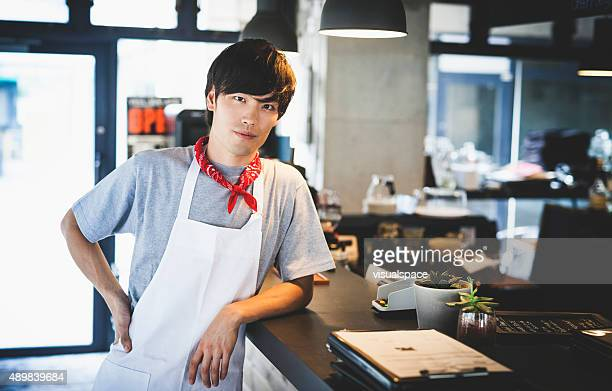 Young Asian Chef Resting on a Bar Counter