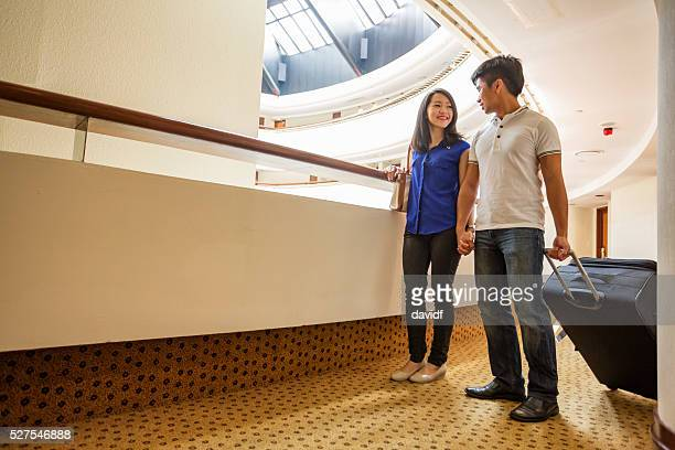 Young Asian Couple Arriving at a Hotel to Check In