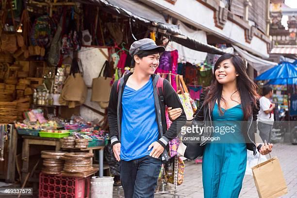 Young Asian Couple Walking in Ubud Market Outdoors Bali Indonesia
