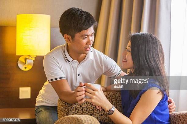 Young Asian Couple With A Hot Drink