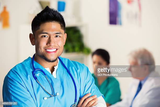 Young Asian doctor is smiling before hospital staff meeting