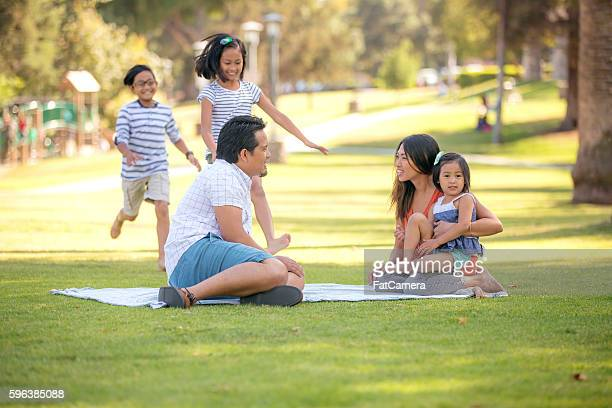Young Asian family playing together at the park