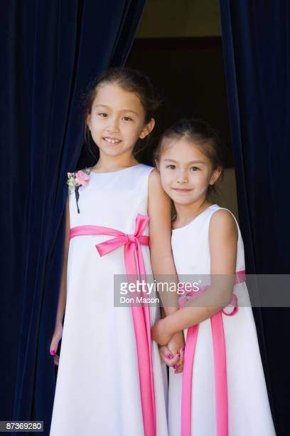 Young Asian flower girls holding hands