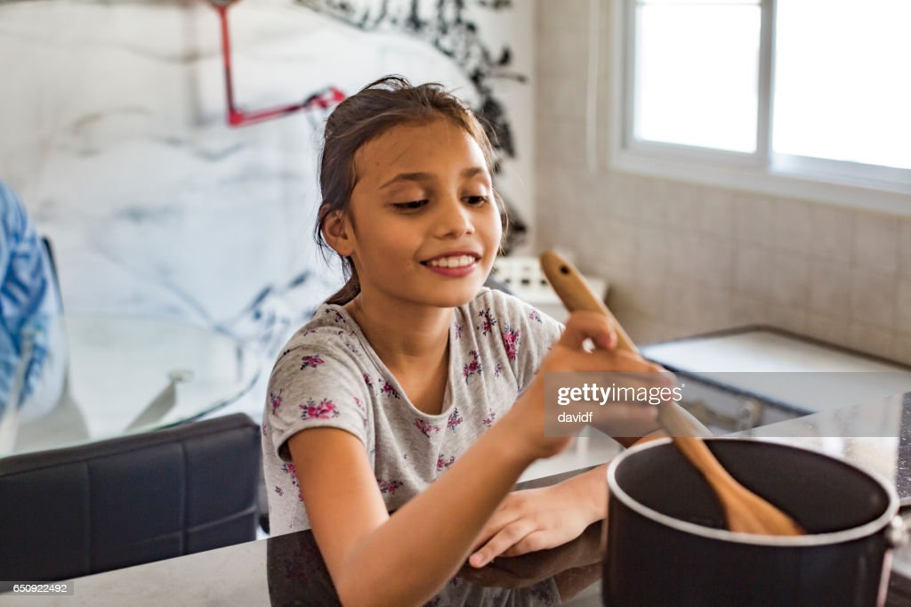Young Asian Girl Cooking : Stock-Foto