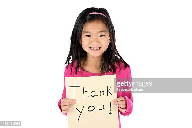 Young Asian girl holding a thank you sign