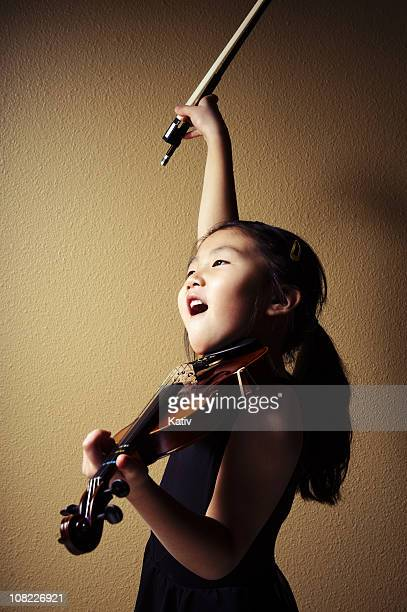Young Asian Girl Playing Violin