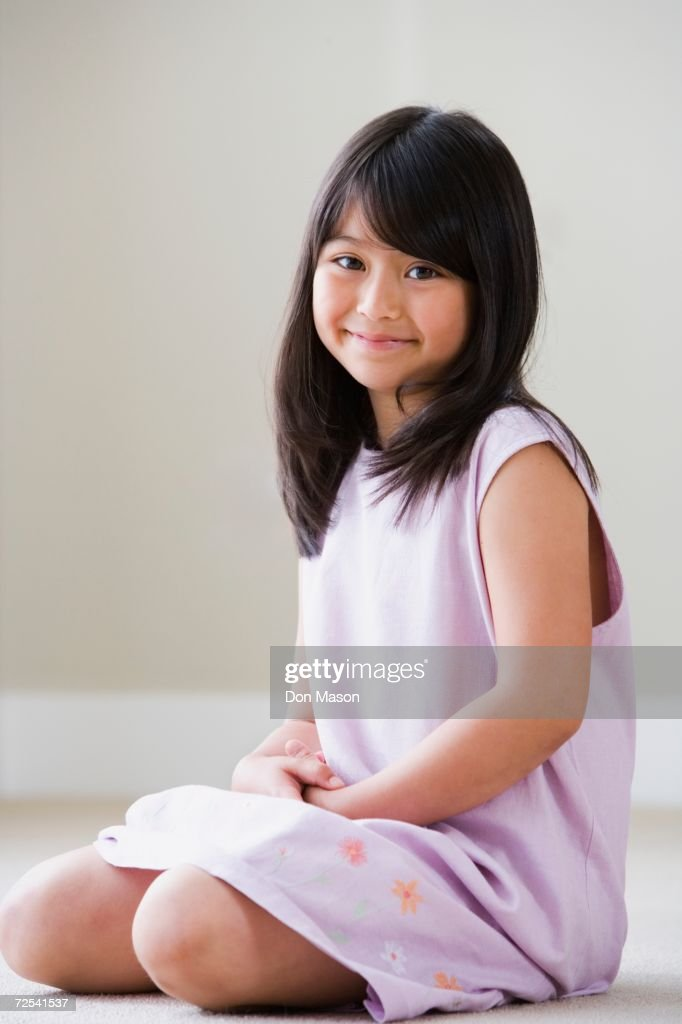 Young Asian Girl Sitting On Floor Smiling Stock Photo ...
