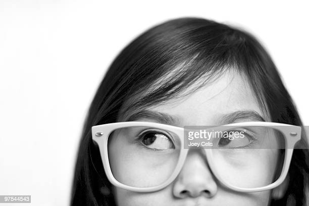 Young Asian girl with large glasses
