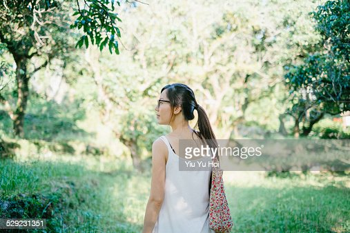 Young Asian hiker walking in the nature