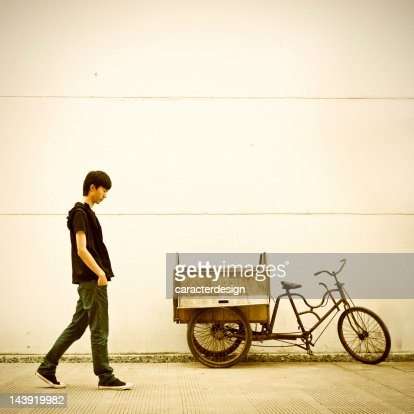 Young asian man walking in the city : Stock Photo