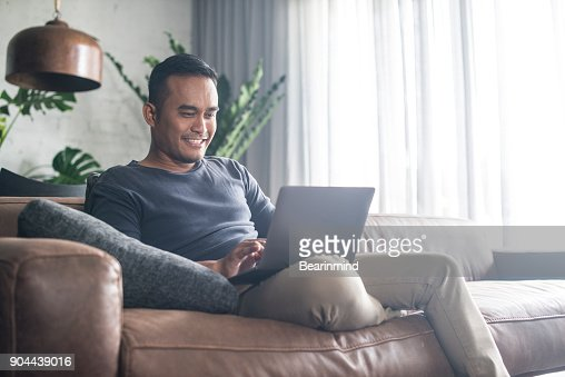 Young Asian man working at home. : Stock Photo