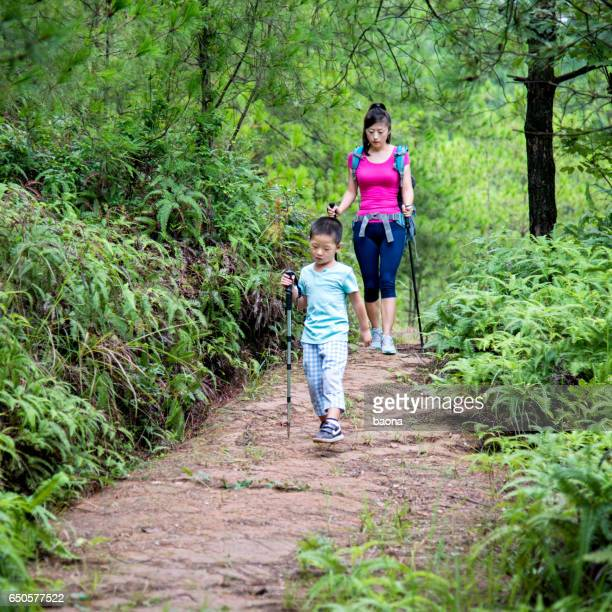 Young asian mother and son hiking