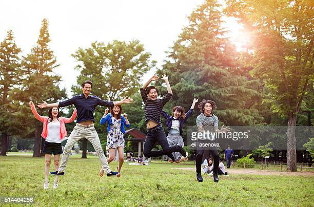 Young asian people having fun in the park, Tokyo.