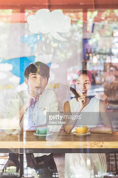 young asian peoples relax at cafe