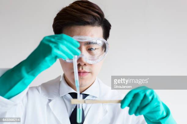 young asian scientist working on research