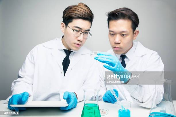 young asian scientists in labratory working on research