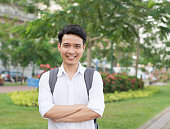 Young Asian student executive with his smiling face, nature background