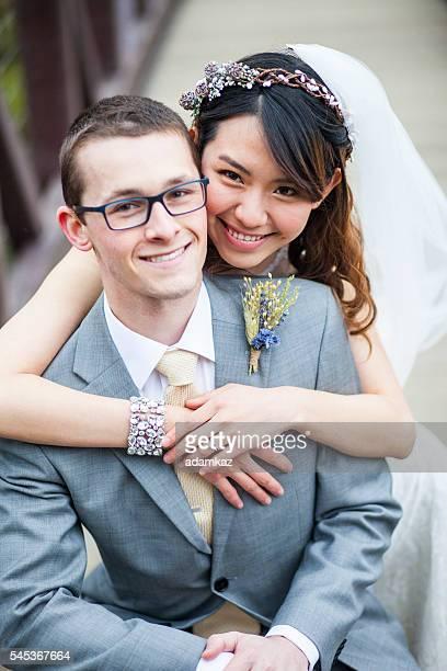 Young Asian Woman and Caucasian Man Wedding Photo