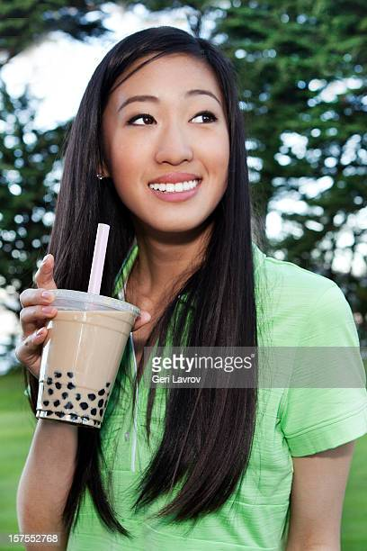 Young Asian woman drinking bubble tea