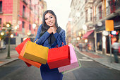 Young asian woman enjoying shopping with paper bag on the street