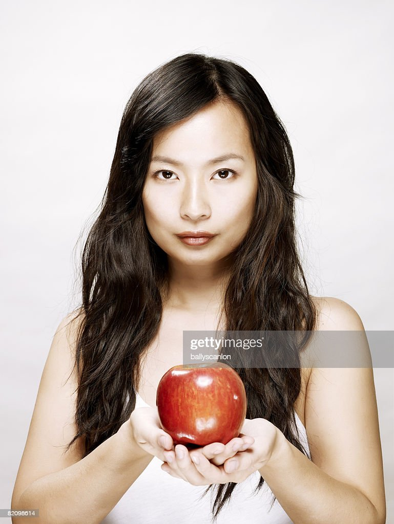 young asian woman holding a red apple : Stock Photo
