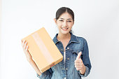 Young Asian Woman holding box with attractive smiling. isolated on white background.