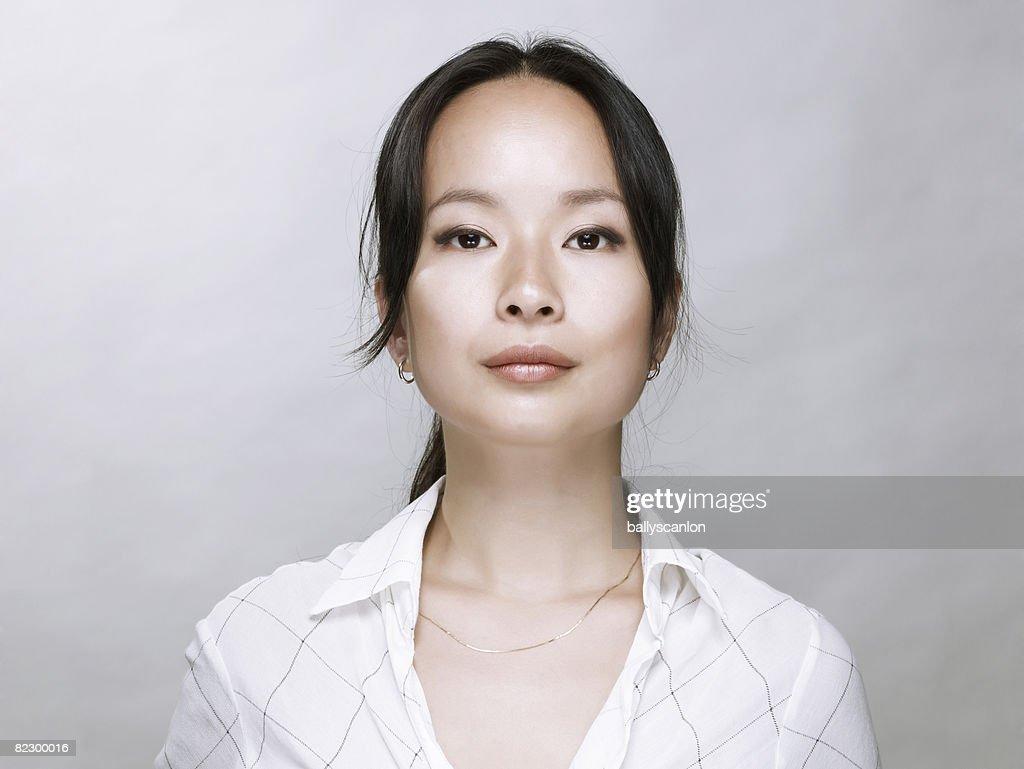 Young Asian woman, looking at camera. : Stock Photo
