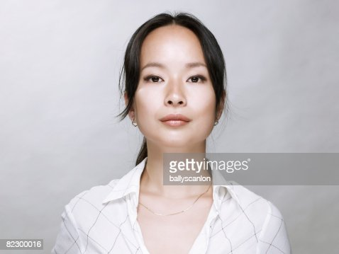 Young Asian woman, looking at camera. : Stock-Foto