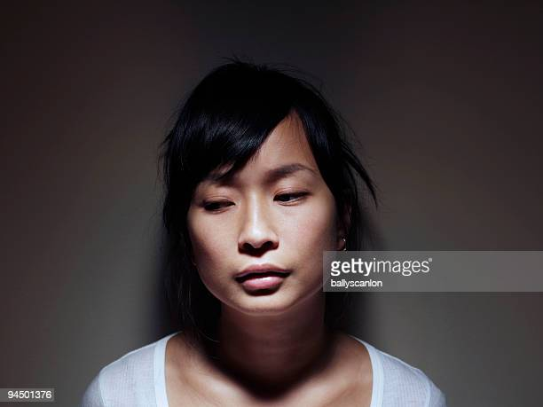 Young Asian Woman Looking Sad.